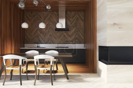 Dark wooden table in a wooden kitchen