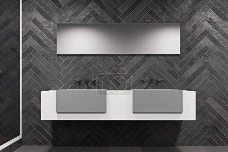 White sink vanity unit in a black bathroom
