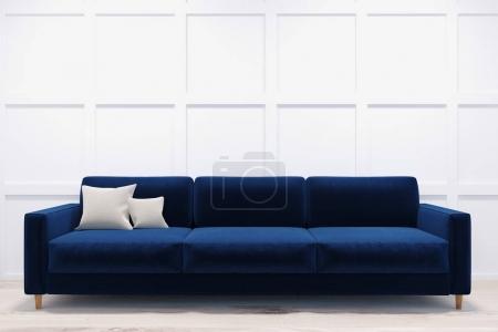 Dark blue sofa in a white room