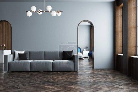 Photo pour Intérieur gris moderne avec un canapé gris, des portes étroites et un sol en bois. Modélisation de rendu 3d - image libre de droit