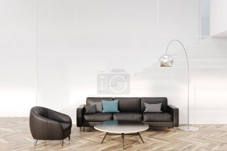 White living room, black sofa and armchair