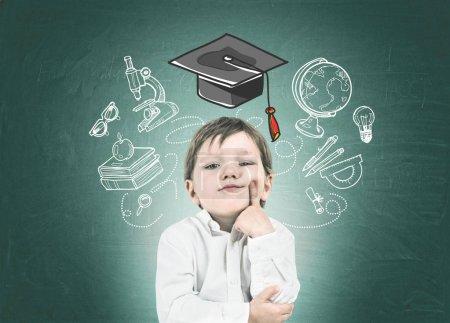 Thinking little boy, finger on cheek, study