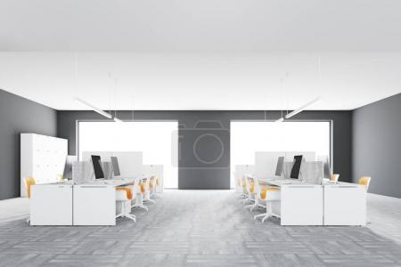 Photo for Loft office interior with gray walls, white desks, computers and original ceiling lamps. A side view. 3d rendering mock up - Royalty Free Image