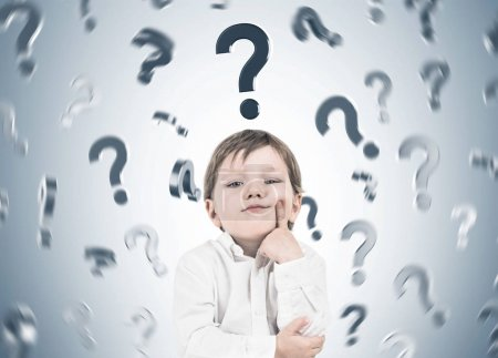 Thinking little boy, question marks rain