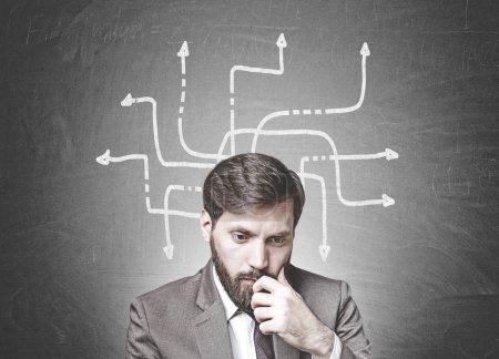 Bearded businessman in doubt, arrows, choice