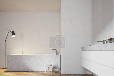 White bathroom, angular tub and sink