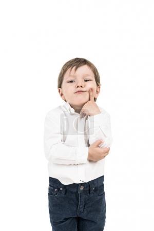 Thinking little boy, finger on cheek, isolated