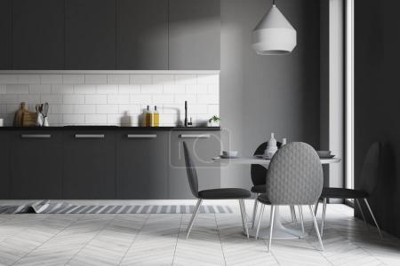 Dark gray kitchen interior, table