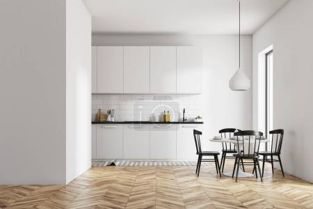Photo for White dining room and kitchen interior with a wooden floor, a round table and black chairs. A blank wall fragment. 3d rendering mock up - Royalty Free Image
