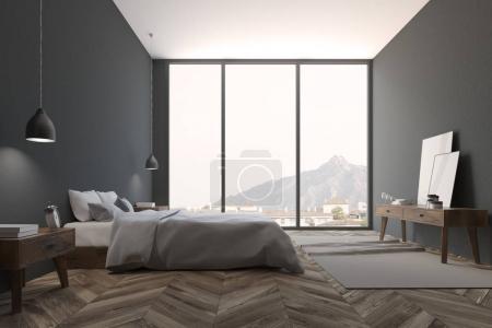 Dark gray Scandinavian bedroom with a wooden floor...