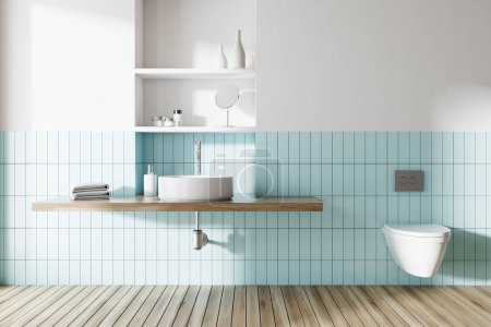 Sink and toilet in a blue and white bathroom