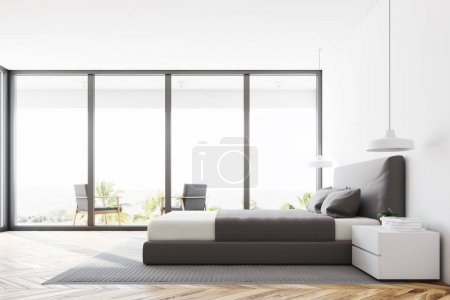 White panoramic bedroom interior with a wooden flo...