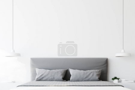 Close up of a double bed with gray pillows standin...