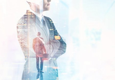 Photo for Side view of a confident young businessman wearing a suit and glasses and standing with crossed arms looking into the distance. A cityscape background. Toned image double exposure mock up - Royalty Free Image