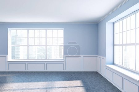 Empty room with blue walls and two windows