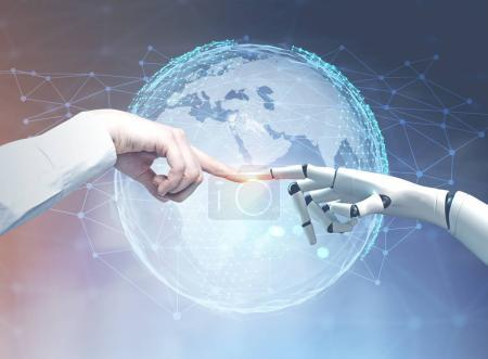 Human and robot hands reaching out, planet