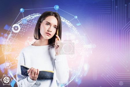 Photo for Thoughtful young woman in smart casual clothes standing with notebook over purple background with double exposure of digital interface. Concept of hi tech in education. Toned image copy space - Royalty Free Image
