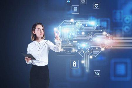 Foto de Jóvenes empresarios serios con computadora tablet trabajando con holograma creativo del cerebro Ai. Concepto de inteligencia artificial y aprendizaje de máquinas. Imagen confusa de la doble exposición - Imagen libre de derechos