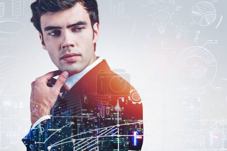 Photo for Handsome thoughtful young businessman in night city with double exposure of creative business strategy sketch. Concept of brainstorming. Toned image - Royalty Free Image