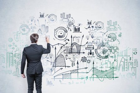 Photo for Young businessman with dark hair drawing creative start up sketch on concrete wall. Concept of business education. Double exposure - Royalty Free Image