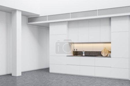 Photo pour Coin cuisine de style industriel avec murs blancs, sol en béton, poteaux et comptoirs blancs avec cuisinière intégrée. 3d Rendu - image libre de droit