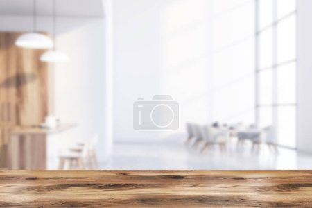 Table in blurry white dining room