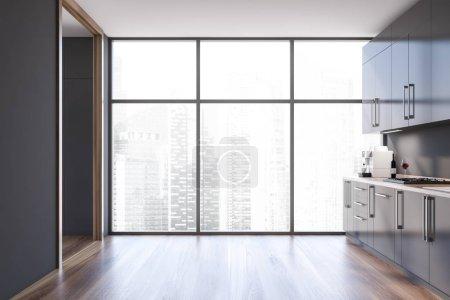 Photo pour Intérieur de la cuisine panoramique avec murs gris, plancher en bois foncé, placards et comptoirs gris avec cuisinière intégrée et fenêtre avec paysage urbain. 3d Rendu - image libre de droit