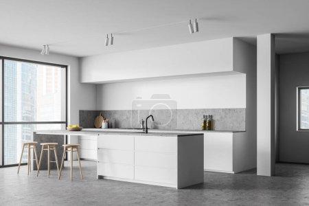 Photo pour Coin cuisine élégante avec murs blancs, sol en béton, comptoirs blancs et bar blanc avec tabourets près de la fenêtre. 3d Rendu - image libre de droit