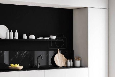 Photo pour Coin cuisine moderne avec murs en marbre noir, plans de travail blancs avec évier et planches à découper intégrés et étagère avec vaisselle et bouteilles au-dessus. 3d Rendu - image libre de droit