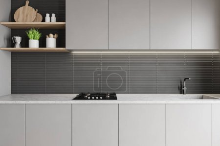 Photo pour Gros plan des comptoirs gris clair avec évier et cuisinière intégrés dans la cuisine moderne avec murs gris et étagères en bois. 3d Rendu - image libre de droit