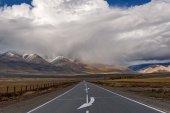 Road mountains asphalt clouds storm