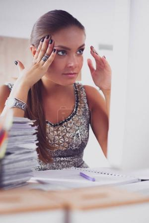 Photo for Young and beautiful businesswoman tired from work in the office. - Royalty Free Image