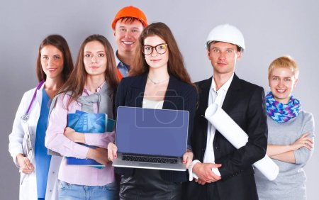 Photo for Smiling businesswoman with laptop  and group of industrial workers. - Royalty Free Image