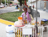 Woman Sells Fresh-Squeezed Juice on Street in Peru