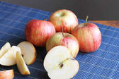 Striped Apples on a Place Mat