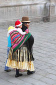 Bolivian Grandmother Carries Grandchild