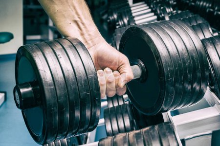 Male fitness concept. Strong man in the gym....