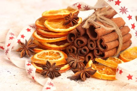 Photo for Dried oranges with anise and cinnamon sticks - Royalty Free Image