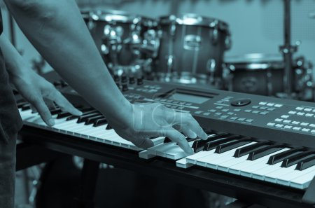 Hands playing keyboard or piano
