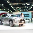 Abstract blurred photo of motor show, car show roo...