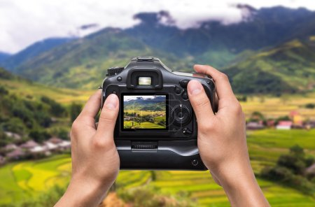 Hand holding camera with photo type...