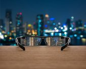Cityscape focused in glasses lenses