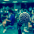 Microphone over the Abstract blurred photo of clas...