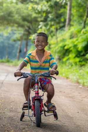 Undefined happy boy riding bicycle