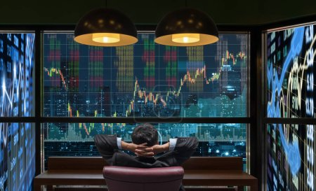 businessman who is looking at stock market