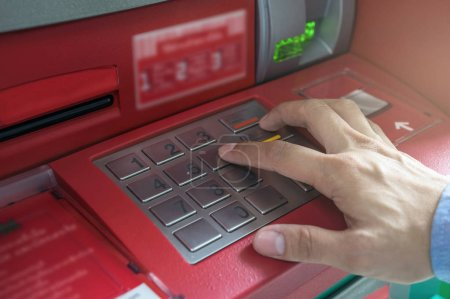 hand pressing the ATM EPP keyboard