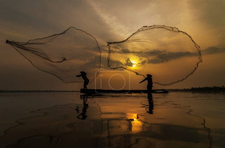Silhouette of asian traditional fishermen