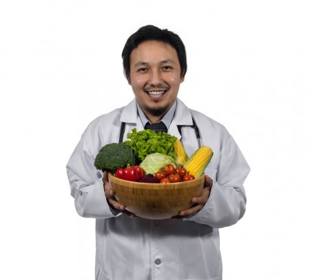 doctor holding fresh vegetables