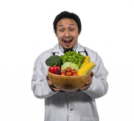 doctor holding fresh vegetables
