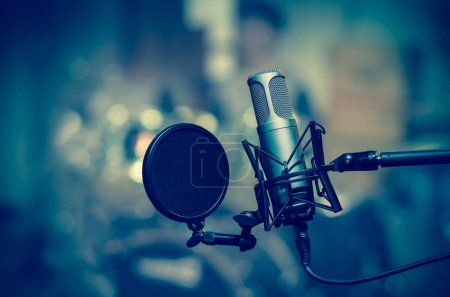 Photo for Professional condenser studio microphone over the musician blurred background, Musical instrument Concept - Royalty Free Image